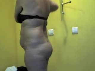 Short hair mature woman undressing and dressing