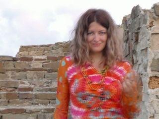 Russian porn model Helena Volga is masturbating her pussy outdoor