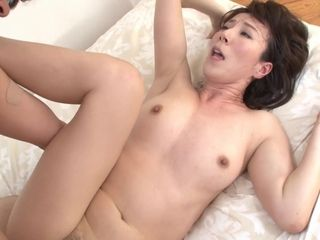Gorgeous Asian MILF gets her tiny pussyhole drilled