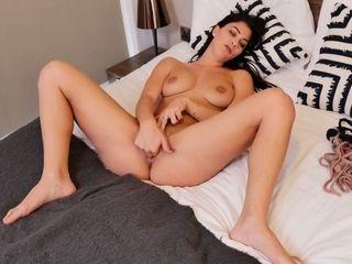 Splendid British milf Roxy Mendez is finger fucking yummy bald pussy