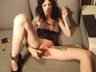 smoking fetish: hot milf dildoing pussy with a cucumber while she smokes