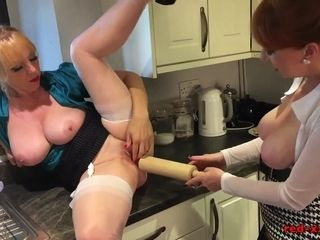 Mature redhead fucks her girlfriend with a rolling pin