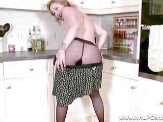 Bored blonde housewife masturbates toys in nylon pantyhose