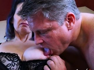 Mature in black negligee is sucking big cock businessman