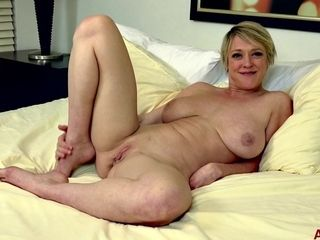 Short-haired blond hair mature Dee Williams