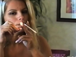 Mature slut blows a lad while smokin' a cigarette