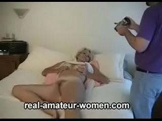 Lovely 60 plus blonde lady posing (three parts)
