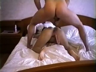 Brunette busty honey takes double penetration on bed