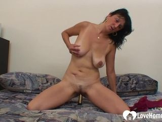 Granny moans while playing with a dildo
