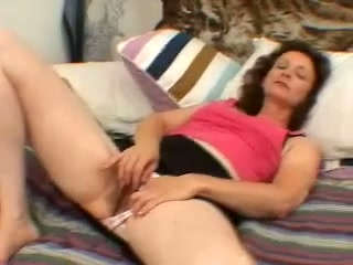 Torrid curly mature lady with big titties is so into petting her wet twat