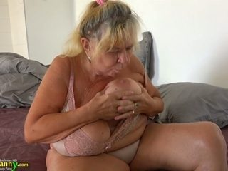 Trashy looking old nanny is fucked by horny young chick with strapon