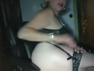 Blonde gilf rubs her wet pierced trimmed pussy and lets her man eat her out on an office chair
