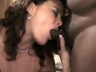 Slut Enjoying A Black And White Cock At The Same Time