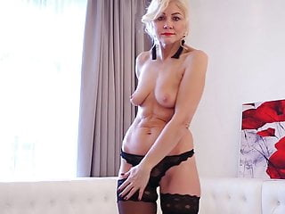 Hot blonde mature lady Sylvie playing with herself