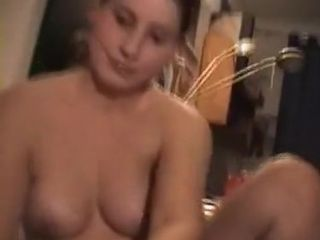 Cute young brunette wife gives her man a blowjob and gets cum on her tits
